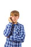Śliczny przystojny młody chłopiec mówienie Fotografia Stock