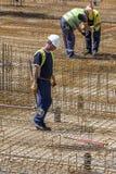 Ślusarzów stalowi pręt i pracownicy Zdjęcie Stock