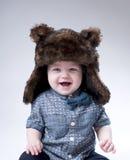 Śmieszna chłopiec w brown futerkowym kapeluszu Obrazy Royalty Free