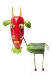 Śmieszna kózka robić świezi warzywa zdjęcie stock