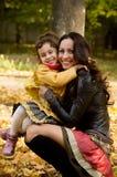 Śmieszna mała dziewczynka i matka Obrazy Stock