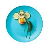 Śmieszna małpa robić warzywa Obrazy Royalty Free