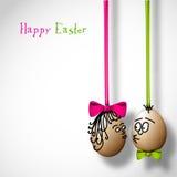 Śmieszni Easter jajka z łękiem Zdjęcia Stock