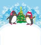 Śmieszni pingwiny dekoruje choinki ilustracji