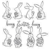 Śmieszni Wielkanocni króliki z świątecznymi dekoracyjnymi jajkami również zwrócić corel ilustracji wektora Konturu rysunek, Wielk royalty ilustracja