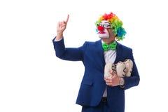 Śmieszny błazenu biznesmen z pieniędzy worków torbami odizolowywać na bielu Zdjęcia Royalty Free