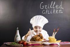 Śmieszny chłopiec szef kuchni Zdjęcie Royalty Free