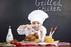 Śmieszny chłopiec szef kuchni Zdjęcia Royalty Free