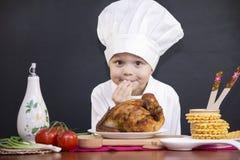 Śmieszny chłopiec szef kuchni Obrazy Royalty Free
