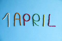 Śmieszny chrzcielnica pierwszy Kwietnia durni dzień pisać w plastecine różni kolory Obraz Stock