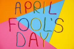 Śmieszny chrzcielnica pierwszy Kwietnia durni dzień pisać w plastecine różni kolory Zdjęcia Stock