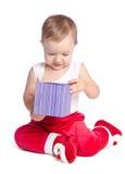 Śmieszny dziecko w Święty Mikołaj spodniach Obraz Stock