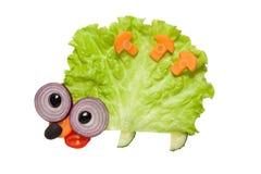 Śmieszny jeż robić warzywa na białym tle Obraz Royalty Free