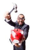 Śmieszny mężczyzna łama jego prosiątko banka Zdjęcia Stock