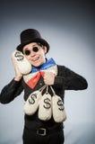 Śmieszny mężczyzna z pieniędzy dolarowymi workami Fotografia Stock