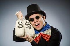 Śmieszny mężczyzna z pieniędzy dolarowymi workami Obrazy Royalty Free