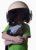 Śmieszny małe dziecko w myśliwskiego pilota hełmie odizolowywającym na białym tle Zdjęcia Stock