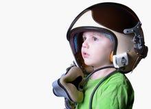 Śmieszny małe dziecko w myśliwskiego pilota hełmie odizolowywającym na białym tle Obraz Stock