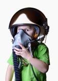 Śmieszny małe dziecko w myśliwskiego pilota hełmie odizolowywającym na białym tle Obrazy Royalty Free