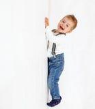 Śmieszny mały dżentelmenu wspinać się oddolny fotografia stock