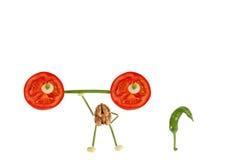 Śmieszny mały orzech włoski podnosi pomidoru baru Zdjęcia Stock