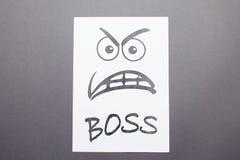 Śmieszny obrazek na białym papierze, gniewna szef twarz zdjęcia stock