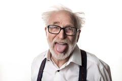 Śmieszny oldster pokazuje jego jęzor Fotografia Royalty Free