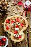 Śmieszny pomysł dla Halloweenowej łasowanie pizzy kulebiaka czaszki dekorował z s obrazy royalty free