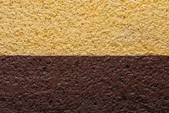 Śmietankowy waniliowy kolor żółty i czekolada - brown ścienna tekstura Fotografia Royalty Free