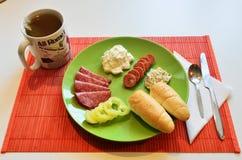 Śniadanie i filiżanka herbata Obrazy Royalty Free