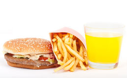 Śniadanie ustawiający: sok pomarańczowy, hamburger i francuz, smażymy odosobnionego na białym tle. Obrazy Stock