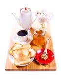Śniadanie z chlebem, miodem i kawą na drewnianej desce grzanki, Zdjęcie Royalty Free
