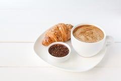 Śniadanie z croissant i filiżanką kawy Fotografia Stock