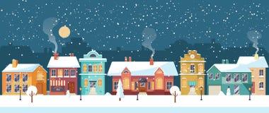 Śnieżna Bożenarodzeniowa noc w wygodnym miasteczku, panorama Obrazy Royalty Free