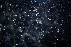 Śnieżna bokeh tekstura na czarnym tle Obrazy Stock