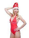 Śnieżna dziewczyna. Blondynka w nakrętce Santa Claus.Portrait na białym tle fotografia stock