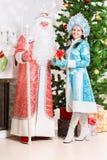 Śnieżna dziewczyna Claus i Santa Obrazy Royalty Free