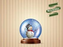 Śnieżna kula ziemska z bałwan pocztówką Fotografia Stock