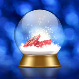 Śnieżna kula ziemska z prezenta pudełkiem inside obrazy royalty free
