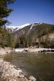 Śnieżne góry i rzeka Obraz Royalty Free