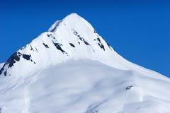 śnieżni górskich szczytów Obrazy Stock