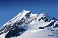 śnieżni górskich szczytów Zdjęcia Royalty Free