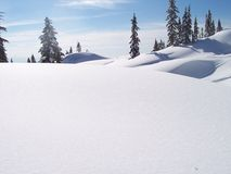 śnieżni objętych wzgórza Zdjęcie Stock