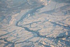 Śnieżni ziemi pęknięcia obrazy stock