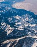 Śnieżny pasmo górskie od samolotu obraz stock