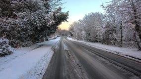 Śnieżny scena kraju pas ruchu z śladami Zdjęcie Royalty Free