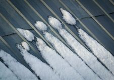 Śnieg na dachowych figurkach Zdjęcie Royalty Free