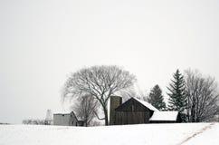 Śnieg zakrywający gospodarstwo rolne Zdjęcie Stock