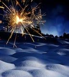 Śnieg zakrywający krajobraz i sparkler - boże narodzenia Zdjęcia Stock