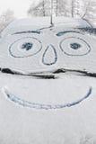 Śnieg zakrywający samochód z smiley obrazy stock